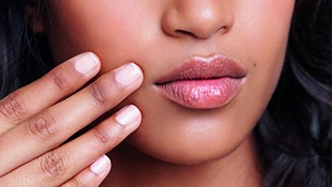 Frau mit gepflegten Lippen
