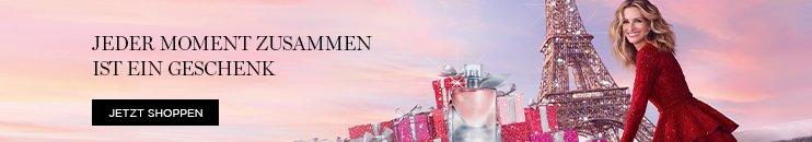 Julia Roberts mit glitzerndem Eiffelturm, Geschenken und La vie est belle