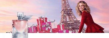 Flakon und Julia Roberts vor glitzerndem Eiffelturm und Geschenken